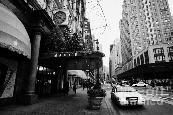 yellow taxi cab waits outside entrance to Macys department store on Broadway and 34th street Print by Joe Fox