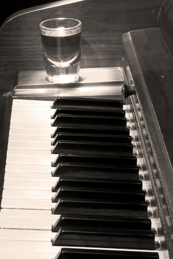 A Shot Of Bourbon Whiskey And The Bw Piano Ivory Keys In Sepia Photograph