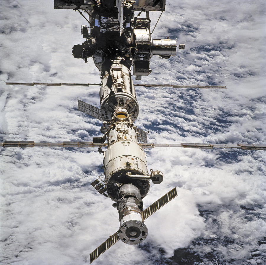 No People; Square Image; Outdoors; Day; Elevated View; Mid-air; Flying; Science; Technology; Travel; Space Station; Space Mission; Earth; Space; Space Exploration; 2009; Planet; Cloud Photograph -  International Space Station by Anonymous