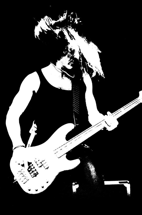A rock star plays bass photograph for Rock star photos for sale