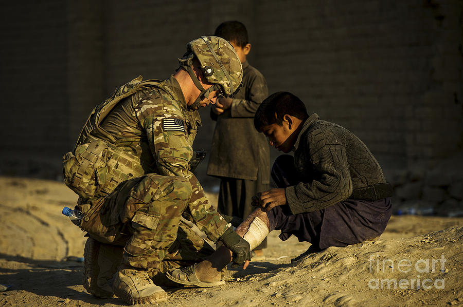 Airman Provides Medical Aid To A Local Photograph  - Airman Provides Medical Aid To A Local Fine Art Print