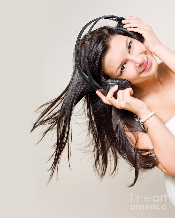 Beautiful Brunette Enjoying Music. Photograph