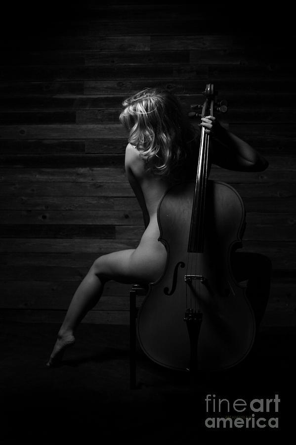 Nude woman playing violin