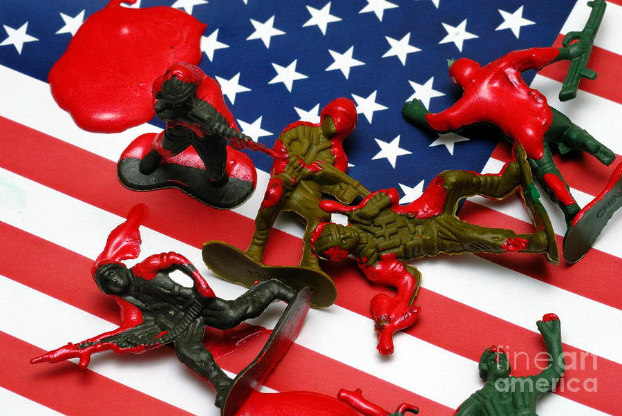 Fallen Toy Soliders On American Flag Photograph