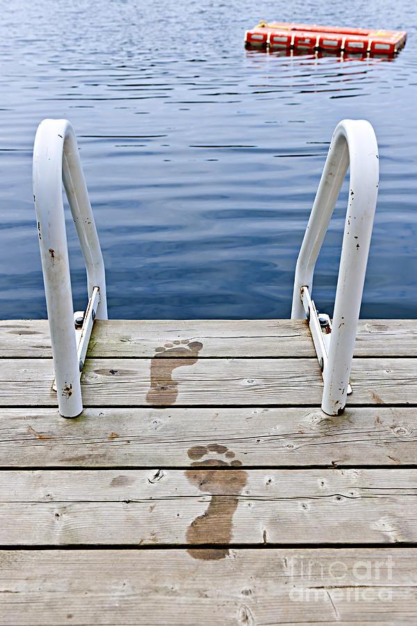 Footprints On Dock At Summer Lake Photograph