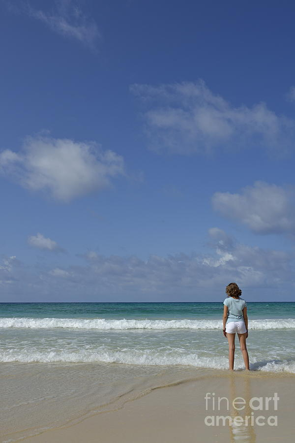 Girl Contemplating Ocean From Beach Photograph