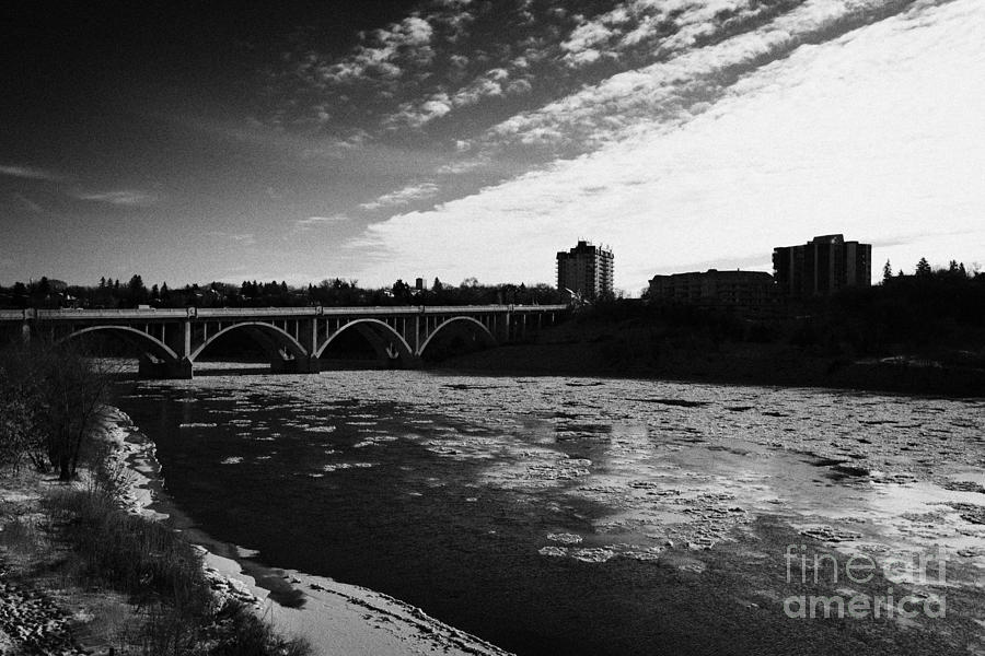 large chunks of floating ice on the south saskatchewan river in winter flowing through downtown Sask Photograph  - large chunks of floating ice on the south saskatchewan river in winter flowing through downtown Sask Fine Art Print