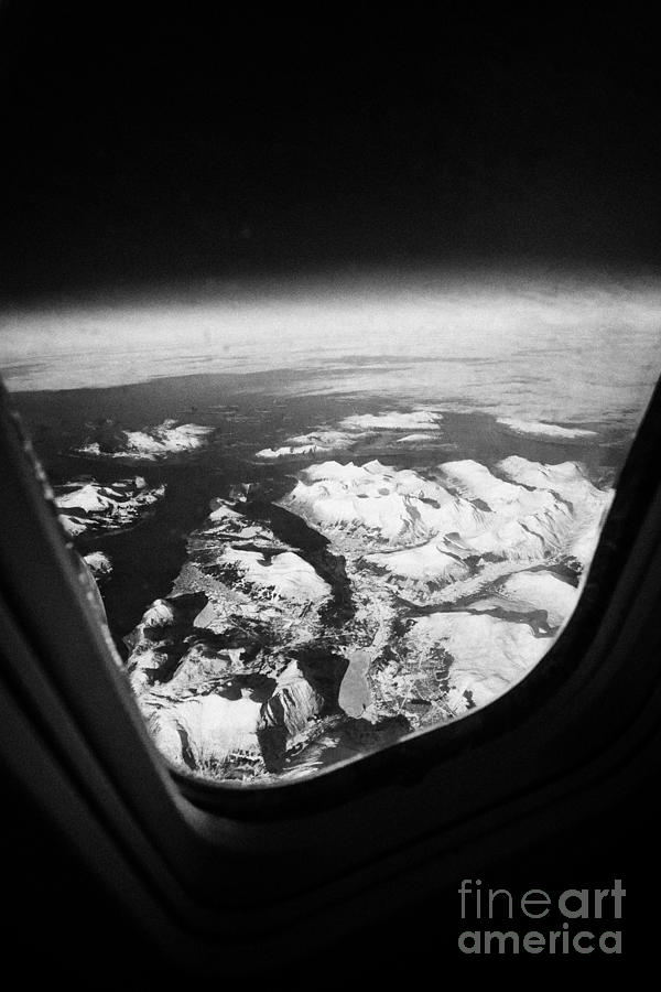 Looking Out Of Aircraft Window Over Snow Covered Fjords And Coastline Of Norway Europe Photograph  - Looking Out Of Aircraft Window Over Snow Covered Fjords And Coastline Of Norway Europe Fine Art Print
