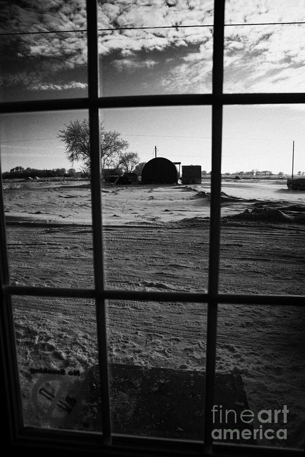 looking out through door window to snow covered scene in small rural village of Forget Saskatchewan  Photograph