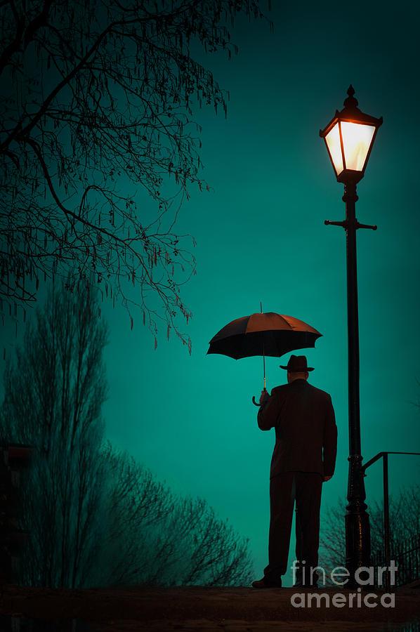 Man Holding An Umbrella Under A Victorian Street Light Photograph