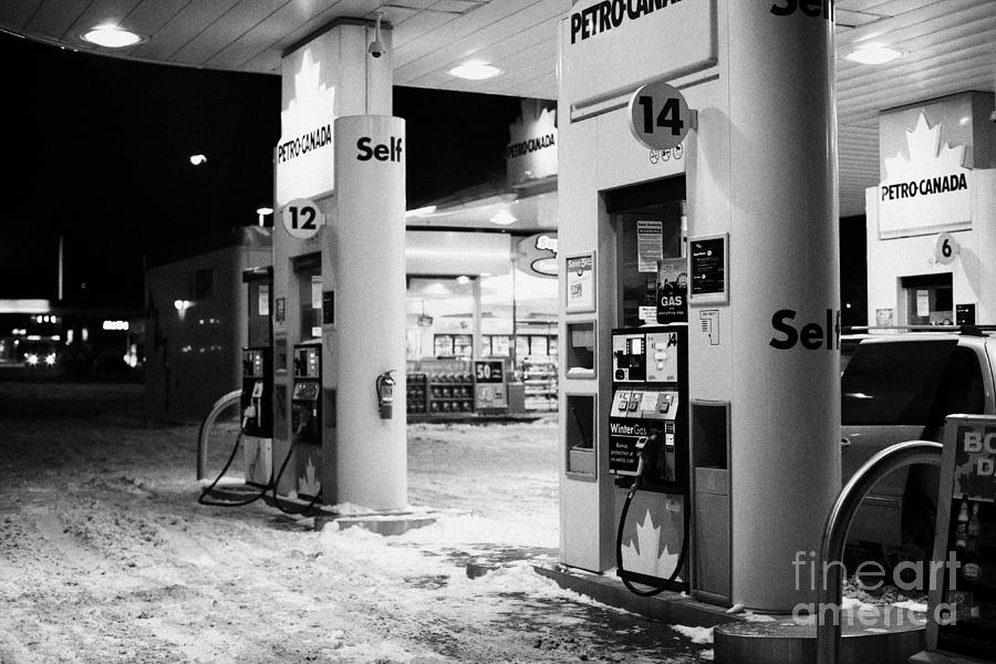 Petrol Photograph - petro canada winter gas fuel pump at service station Regina Saskatchewan Canada by Joe Fox