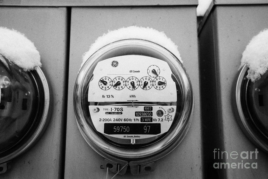 snow covered electricity meters in Saskatoon Saskatchewan Canada Photograph