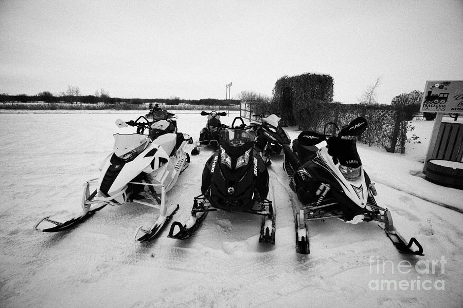 snowmobiles parked in Kamsack Saskatchewan Canada Photograph