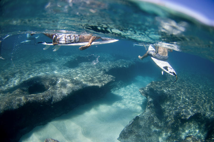 Surfers Over Reef. Photograph