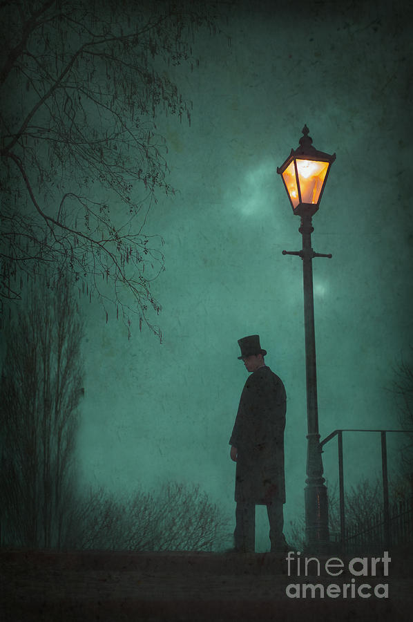 Victorian Man Standing Next To An Illuminated Gas Lamp Photograph
