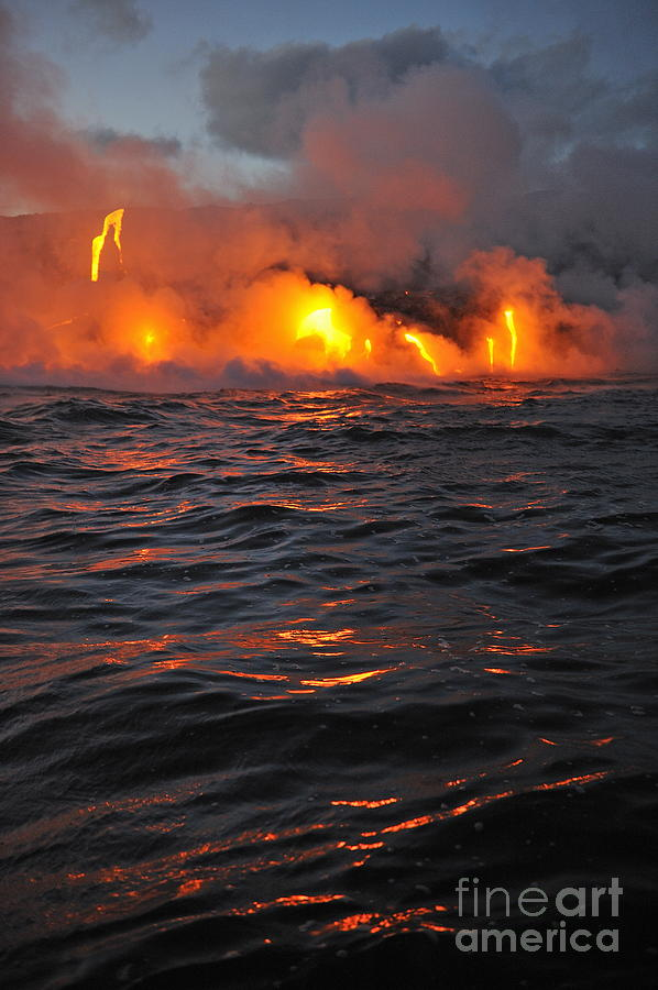 Steam Rising Off Lava Flowing Into Ocean Photograph