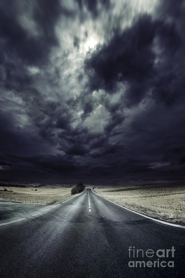 An Asphalt Road With Stormy Sky Above Photograph