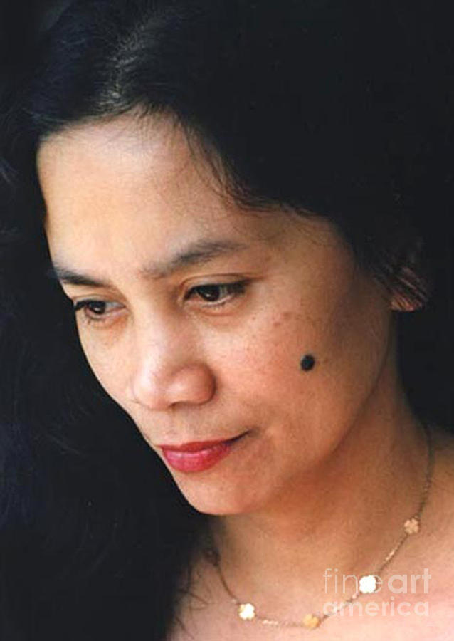 Filipina Beauty With A Mole On Her Cheek Photograph