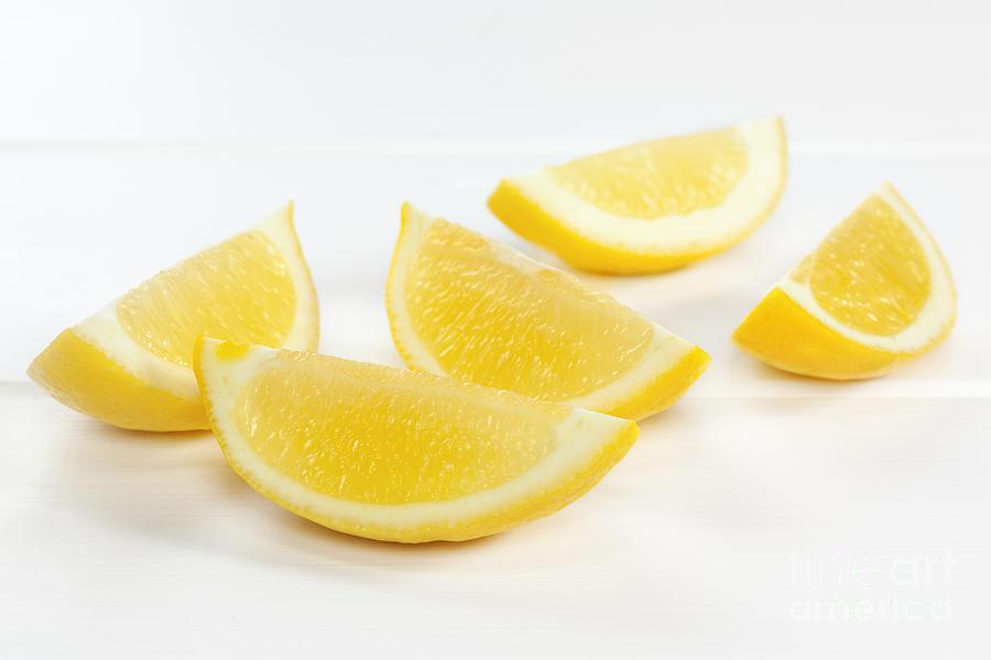 Lemon Wedges On White Background Photograph