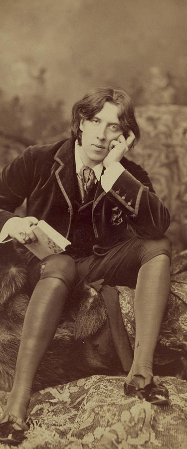 Oscar; Wilde; Irish; Writer; Poet; Author; Dandy; Photograph; Sepia; Black; White; Velvet; Smoking; Jacket; Breeches; Wearing; Stockings; Full; Length; Seated; Oscar Wilde Photograph - Oscar Wilde 1882 by Napoleon Sarony