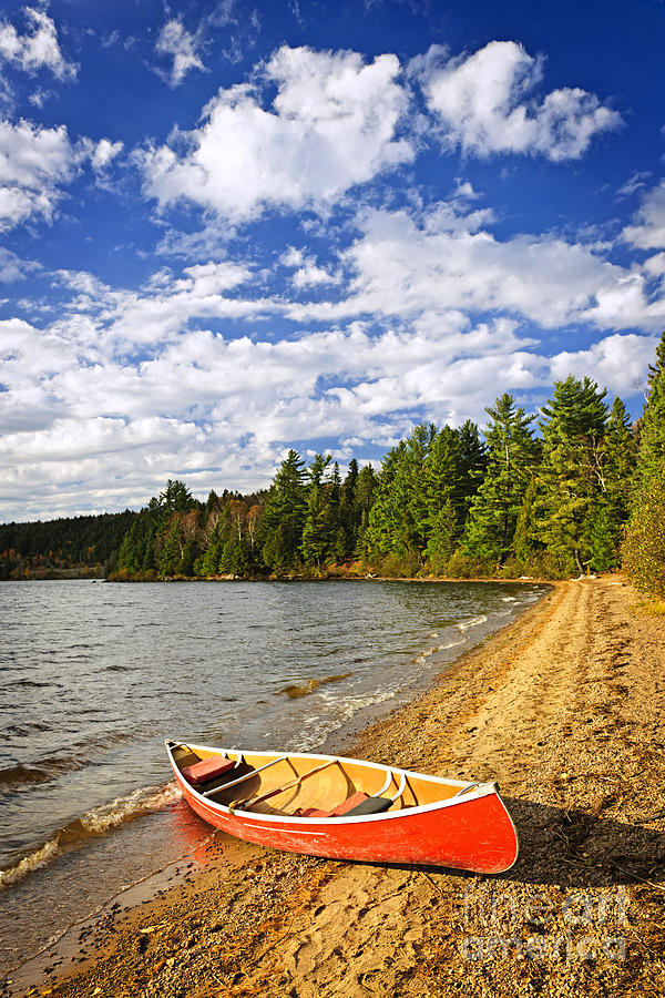 Red Canoe On Lake Shore Photograph