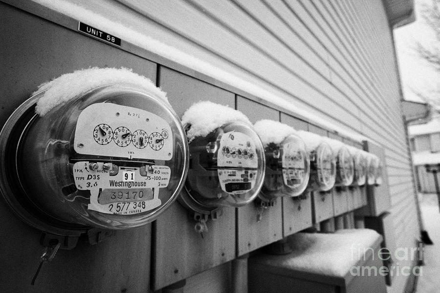 snow covered electricity meters in Saskatoon Saskatchewan Canada Photograph  - snow covered electricity meters in Saskatoon Saskatchewan Canada Fine Art Print