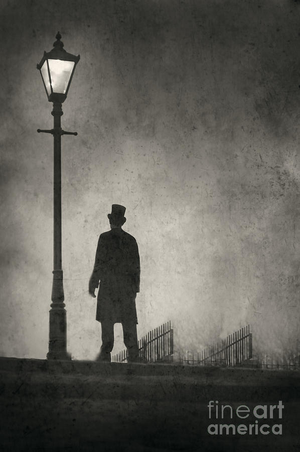 Victorian Man Standing Next To An Illuminated Gas Lamp Photograph