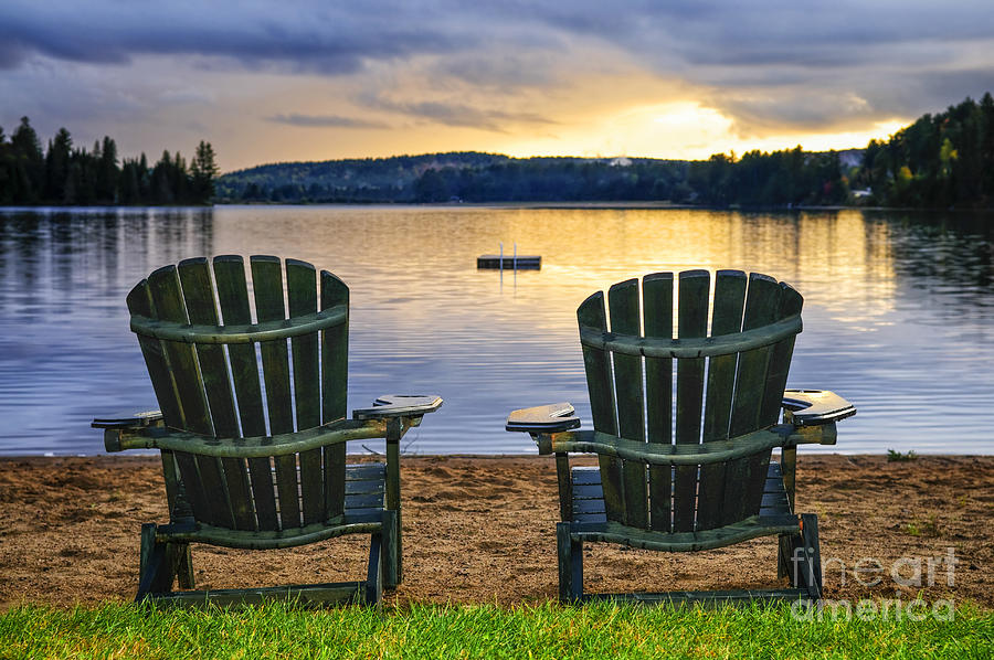 Wooden Chairs At Sunset On Beach Photograph
