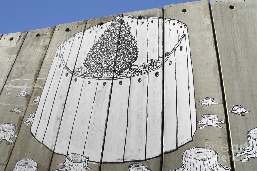 A Banksy Graffiti On The Separation Wall In Palestine Photograph