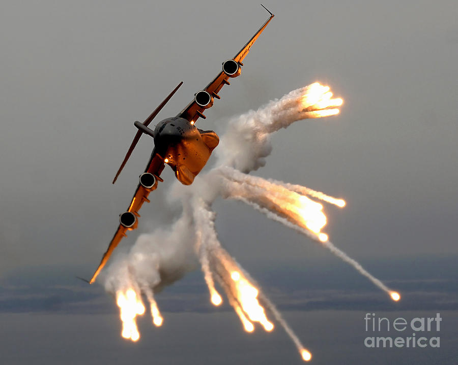 A C-17 Globemaster IIi Releases Flares Photograph
