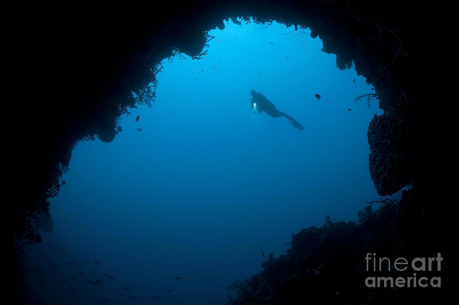 A Diver Explores A Cavern In Gorontalo Photograph