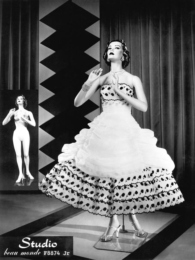 A Fashionable Mannequin And Her Unclothed Version In The Backgro Photograph