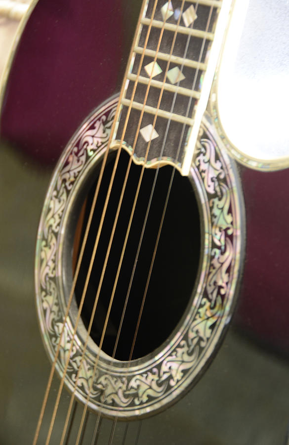 A Guitar That Is A  Red And Green Top Of The Line Photograph