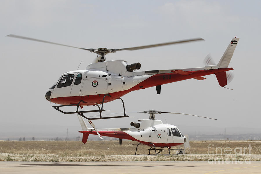 A Pair Of As350 Squirrel Helicopters Photograph