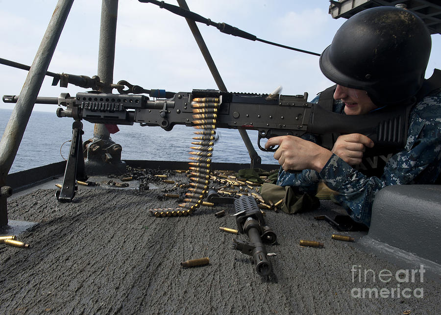 A Sailor Fires An M-240b Machine Gun Photograph  - A Sailor Fires An M-240b Machine Gun Fine Art Print