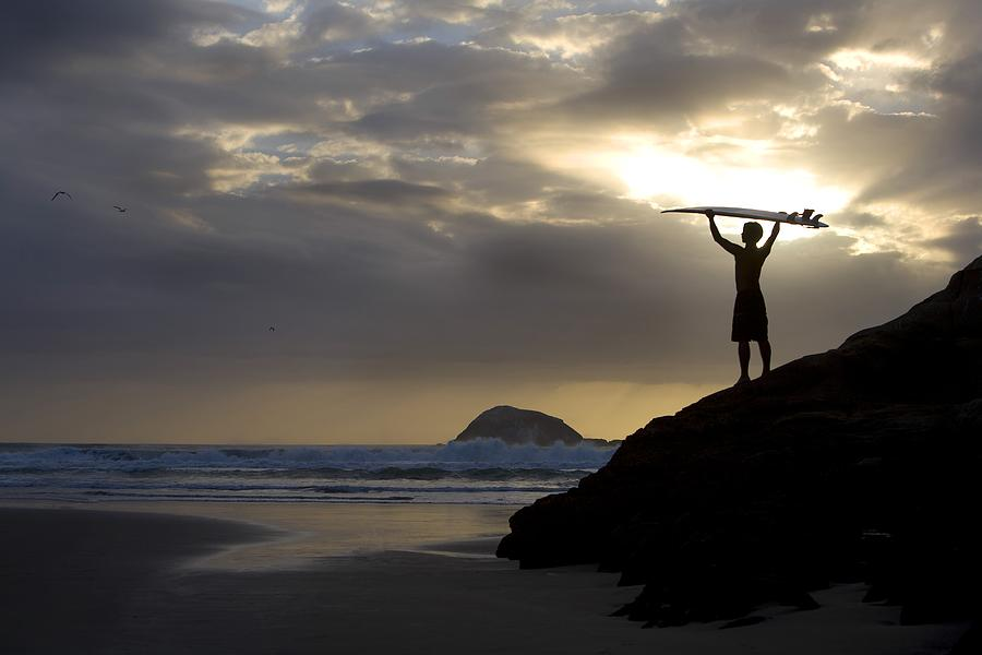 Outdoors Photograph - A Surfer On Muriwai Beach New Zealand by Deddeda