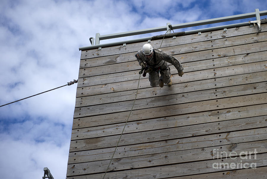 A U.s. Soldier Runs Down A 40-foot Photograph  - A U.s. Soldier Runs Down A 40-foot Fine Art Print