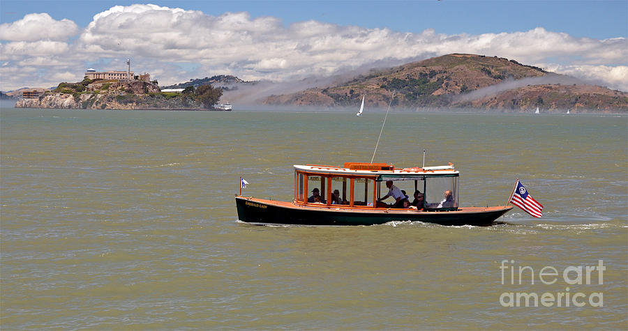A Water Taxi Cruises Past Alcatraz Photograph