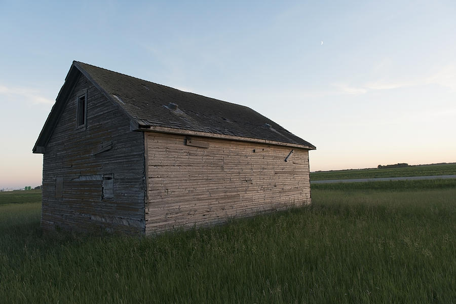 A Wooden Shed In The Middle Of A Grass Photograph