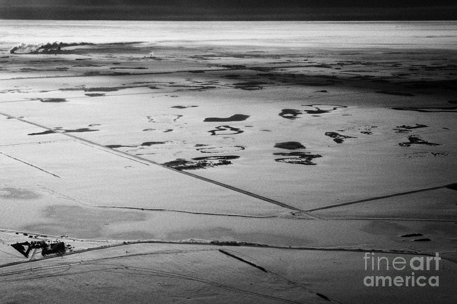 aerial view of snow covered prairies and remote isolated farmland in Saskatchewan Canada Photograph  - aerial view of snow covered prairies and remote isolated farmland in Saskatchewan Canada Fine Art Print