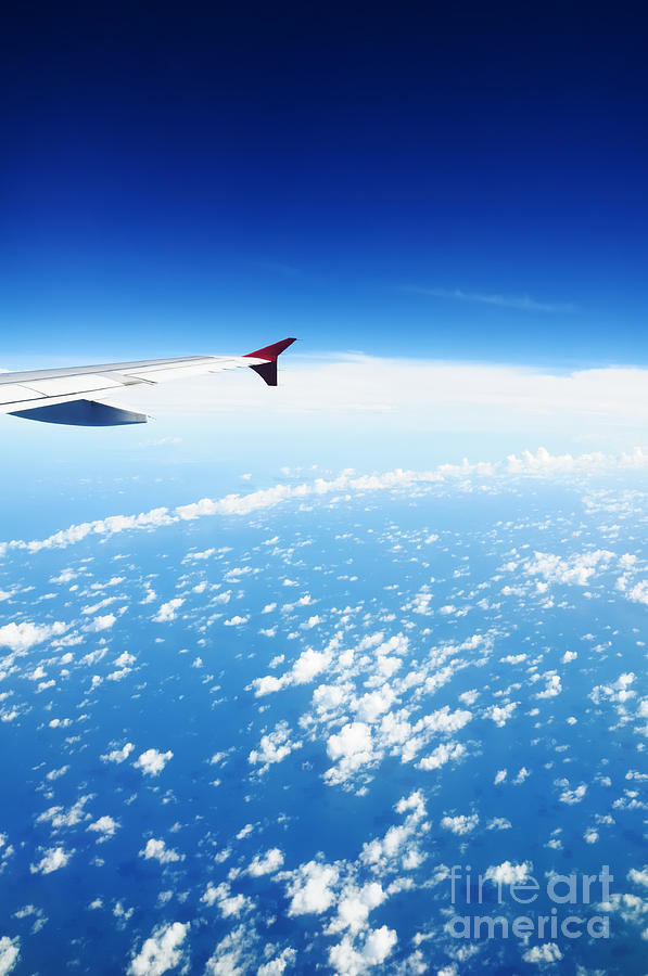 Airplane Wing Against Blue Sky Horizon Photograph
