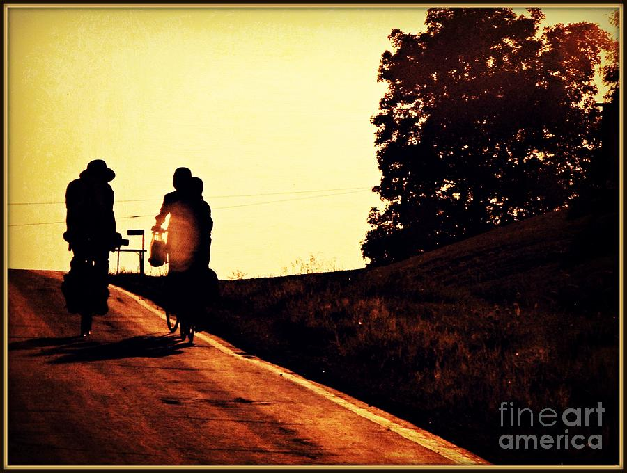 Amish Family Cycles Into Sunset Photograph