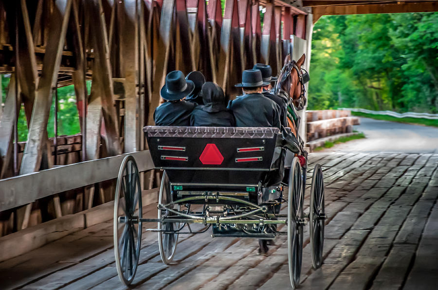 Amish Family On Covered Bridge Photograph