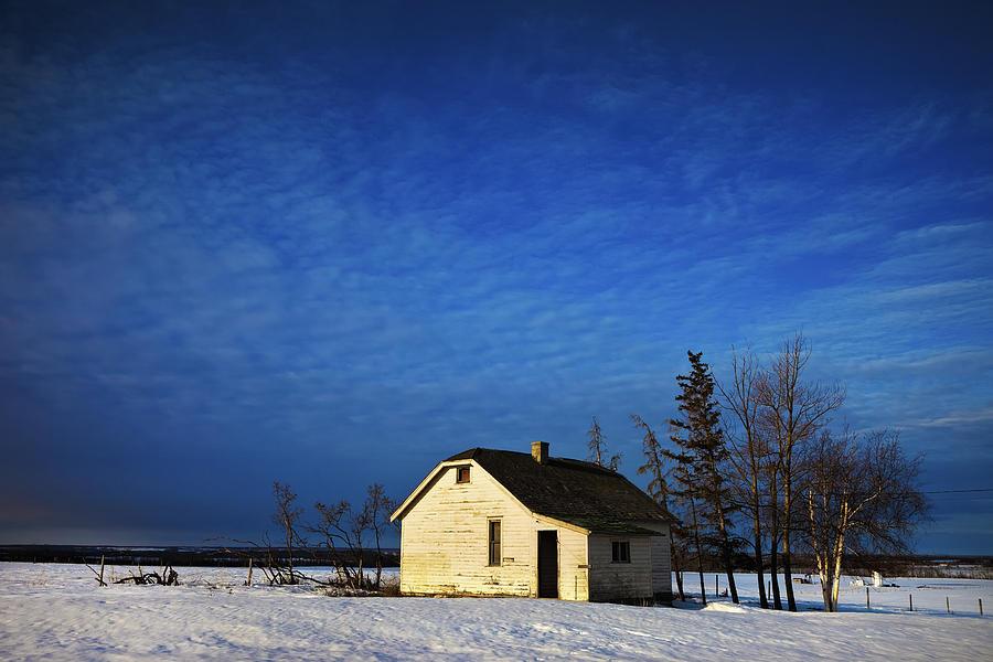 An Abandoned Homestead On A Snow Photograph