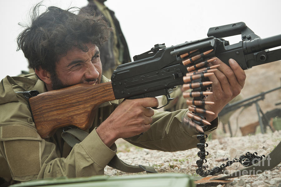 An Afghan Local Police Officer Fires Photograph
