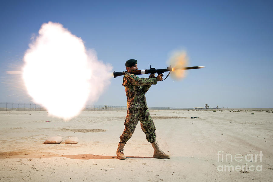 An Afghan National Army Soldier Fires Photograph