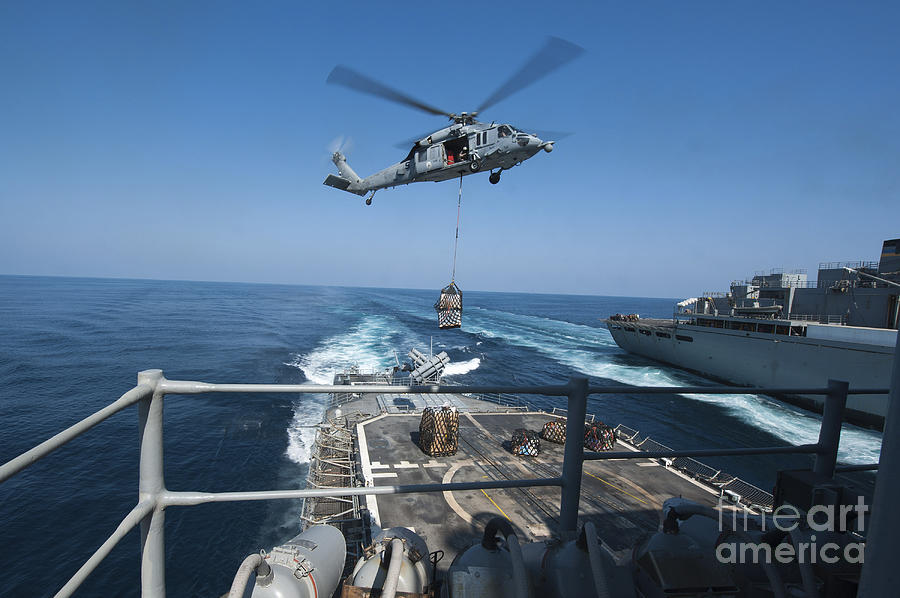 An Mh-60s Sea Hawk Brings Pallets Photograph