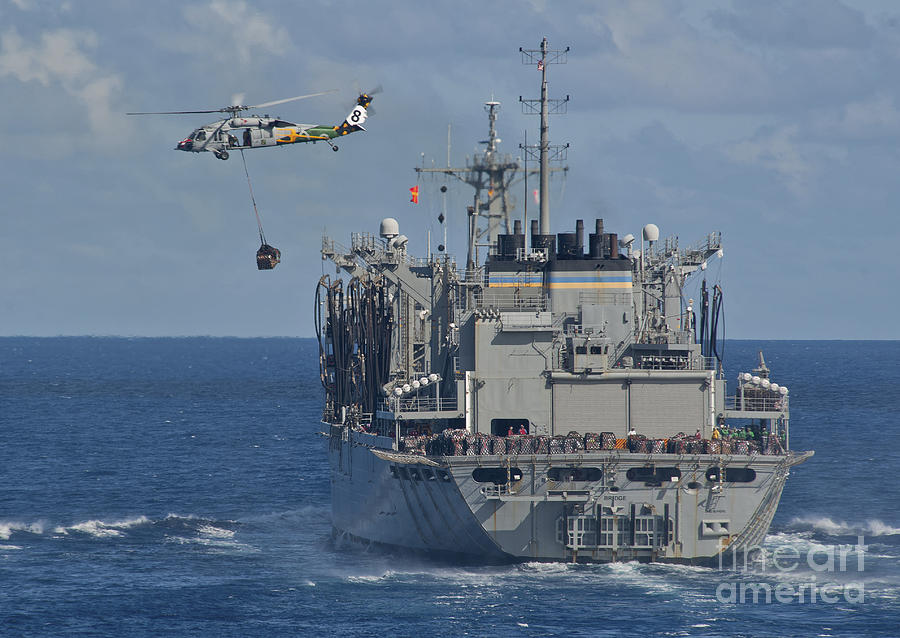 An Mh-60s Sea Hawk Conducts A Vertical Photograph  - An Mh-60s Sea Hawk Conducts A Vertical Fine Art Print