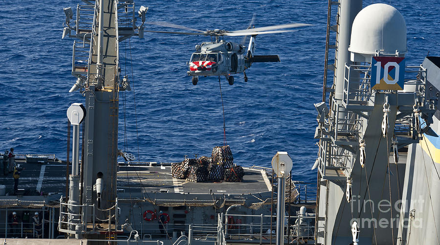 An Mh-60s Sea Hawk Delivers Supplies Photograph  - An Mh-60s Sea Hawk Delivers Supplies Fine Art Print