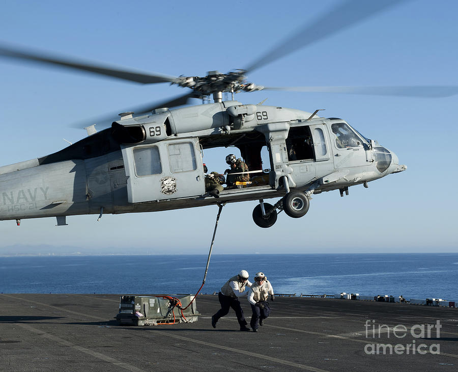 An Mh-60s Sea Hawk Helicopter Prepares Photograph  - An Mh-60s Sea Hawk Helicopter Prepares Fine Art Print